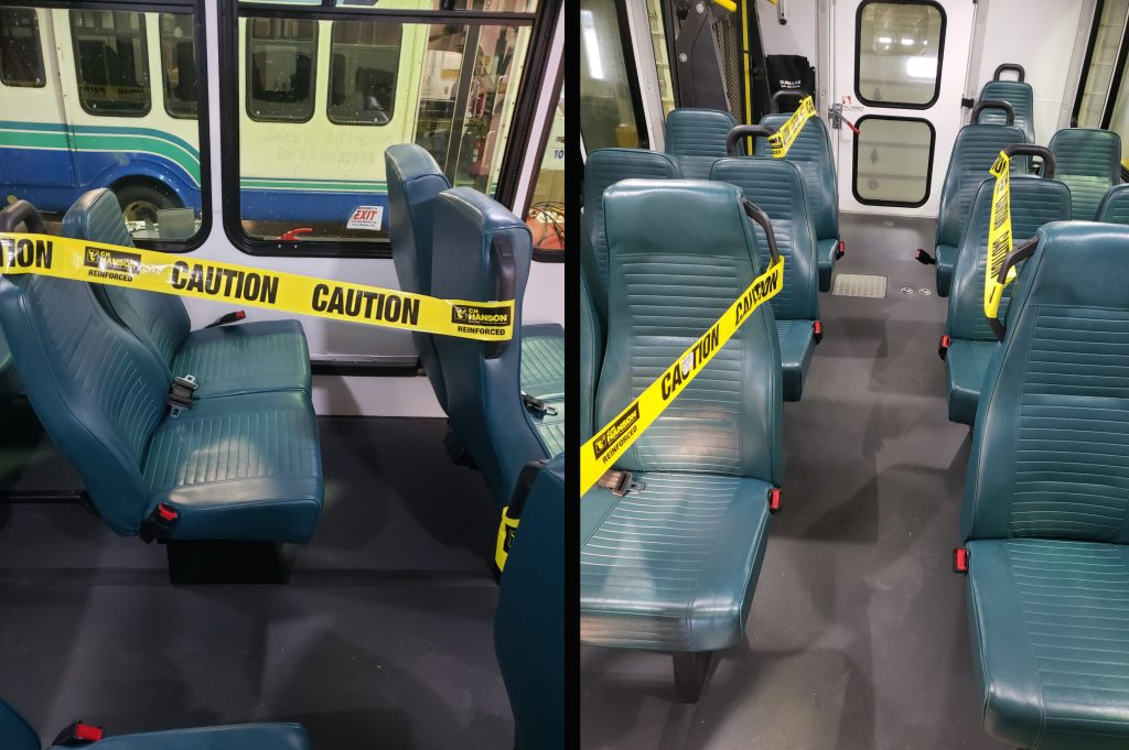 Buses with taped seats to ensure distance between passengers during COVID-19 emergency
