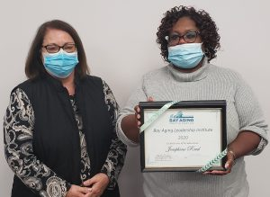 two women,one holding certificate